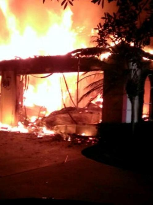 Flames engulf a Florida house owned by former tennis pro James Blake. Photos Reuters