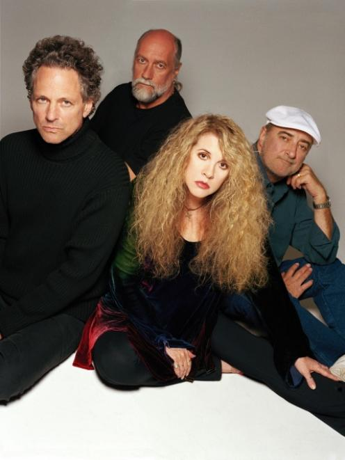Fleetwood Mac will play in Auckland in December as a legal dispute intensifies over the group's...