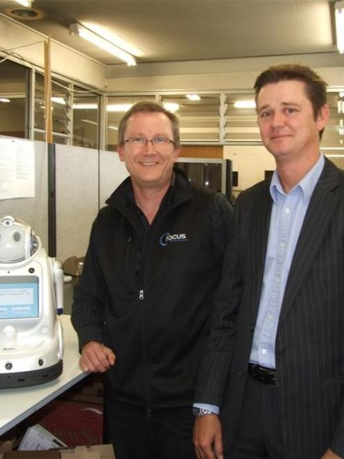 Focus Technology Group senior technician Martin Little and Gore Health Ltd chief executive Karl...