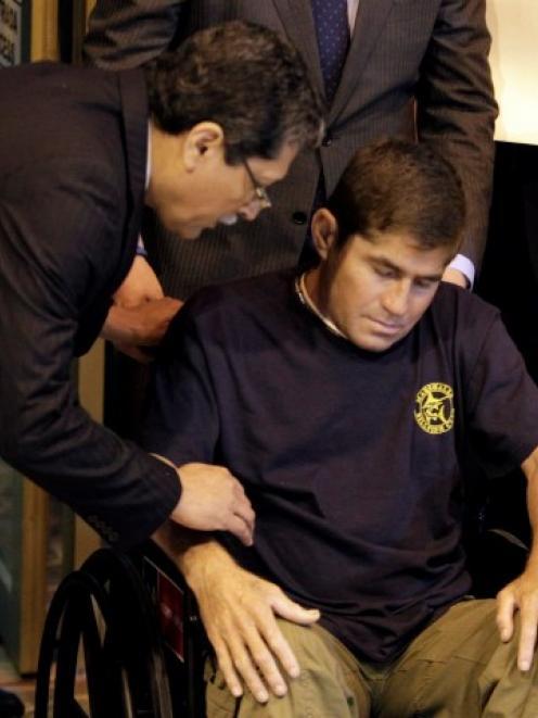 Foreign Minister of El Salvador Jaime Miranda (L) talks with Jose Salvador Alvarenga as the...