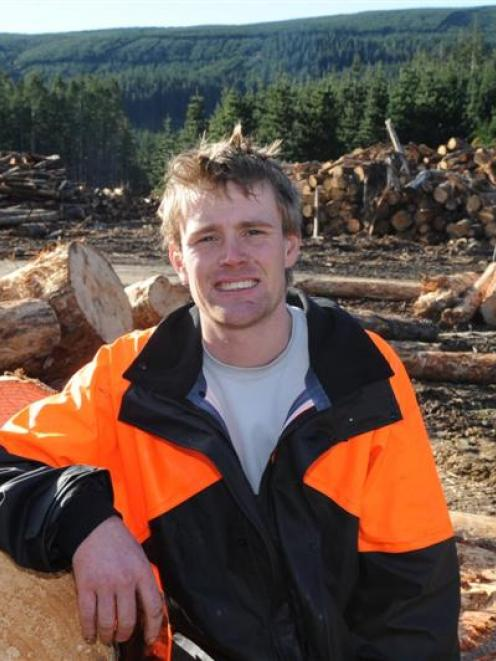 Forestry worker Gareth Williams at work on a site near Dunedin. Photo by Linda Robertson.