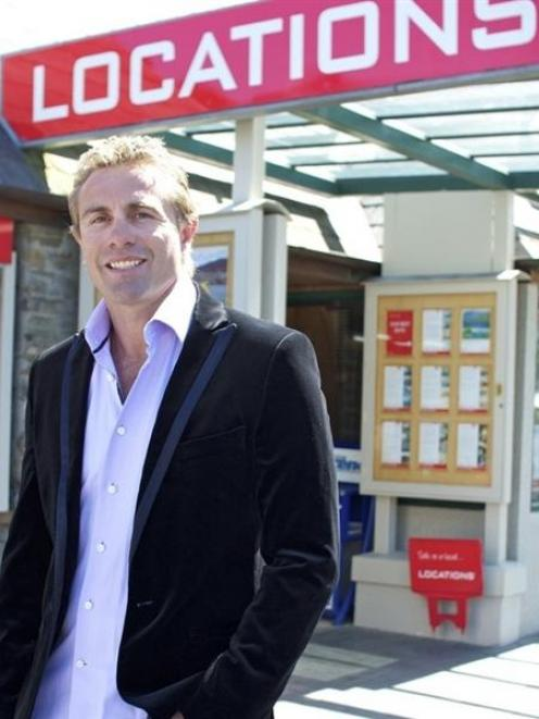 Former All Blacks captain Justin Marshall in front of the Locations Realty office, Queenstown....