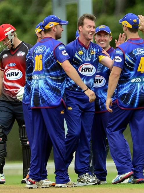 Former Australian fast bowler Brett Lee (centre) celebrates his brilliant run-out of Andrew Ellis...