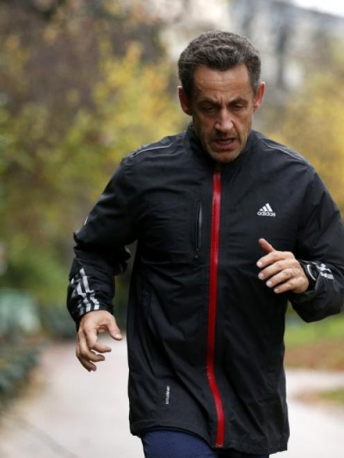 Former French President Nicolas Sarkozy jogs in Paris. Photo by Reuters