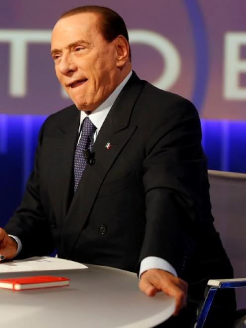 Former Italian prime minister Silvio Berlusconi sits before the taping of the talk show 'Otto e...