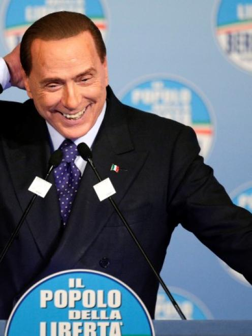 Former Italian prime minister Silvio Berlusconi speaks during a political rally in downtown Rome...