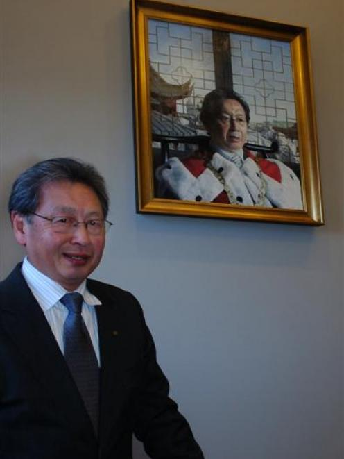 Former mayor Peter Chin with his portrait, which was unveiled at the Dunedin Municipal Chambers...