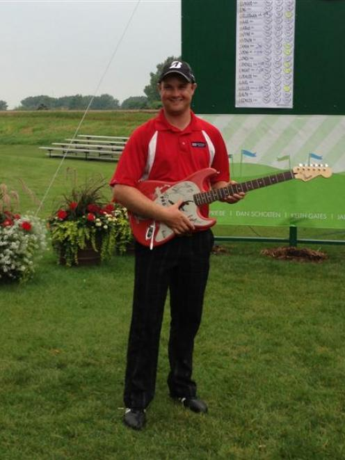 Former Otago golfer Thomas Campbell with the 'trophy' he got for winning a tournament on the...