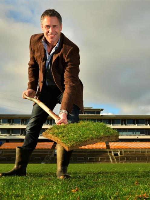 Former Otago rugby player and All Black Marc Ellis claims a piece of turf at Carisbrook yesterday...