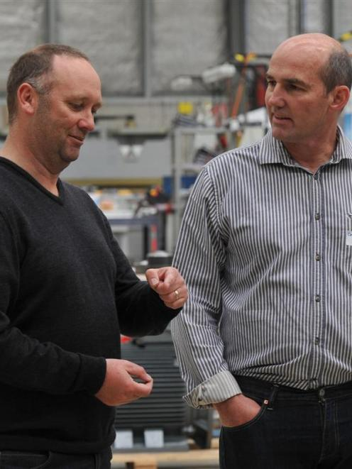 Former Scott Technology Ltd electrical engineer Andy Burt (left) chats with company chief...