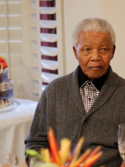 Former South African president Nelson Mandela, seen celebrating his 94th birthday at home in Qunu...