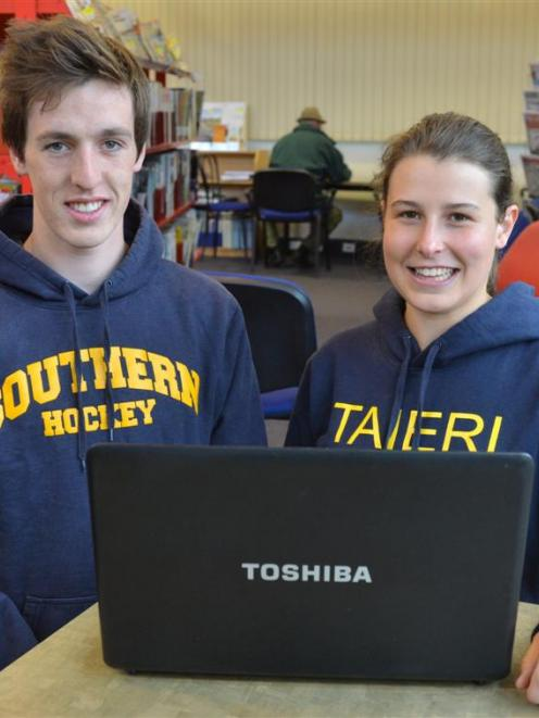 Former Taieri College pupils  Jarrod Casey and Hannah Grant check their NCEA results on a  laptop...