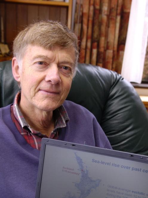 Former University of Otago School of Surveying dean Prof John Hannah examines sea-level rise data...
