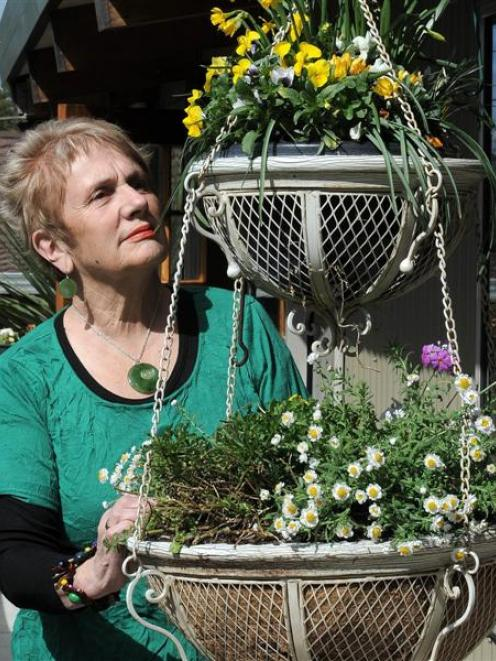 Frana Cardno tends her flowers before leaving to spend Christmas and New Year in the United...