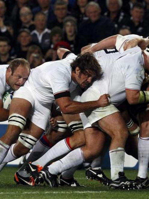 France players contest a scrum during their Rugby World Cup Pool A match against New Zealand....