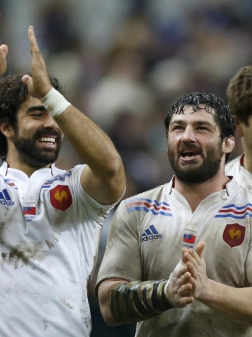 France's Yoann Huget (left) and Yannick Forestier react at the end of their team's rugby test...
