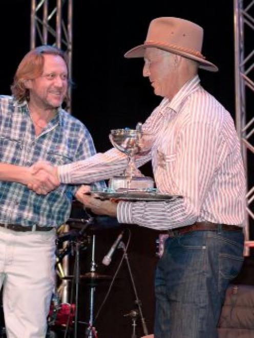 Francesco Botto Poala, of Reda, presents Bill Sutherland with the Otago Merino Association clip...
