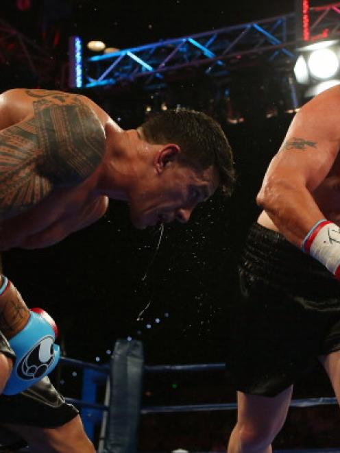 Francois Botha (L) takes on Sonny Bill Williams in their heavyweight bout at the Brisbane...