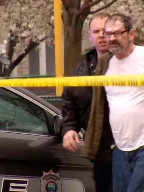 Frazier Glenn Cross is led to a police car after his arrest following the shootings REUTERS/KCTV5