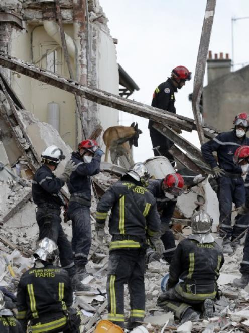 French firefighters search the rubble of a collapsed building in Rosny-Sous-Bois, near Paris....