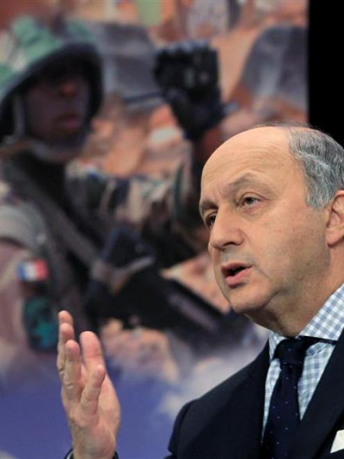 French Foreign Minister Laurent Fabius holds a news conference after NATO gave the go-ahead to...