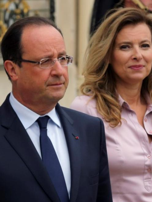 French President Francois Hollande (L) and first lady Valerie Trierweiler together at the Elysee...