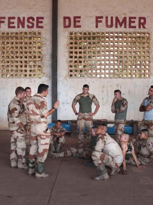 French soldiers listen to instructions in a hangar at the Malian army air base in Bamako. REUTERS...