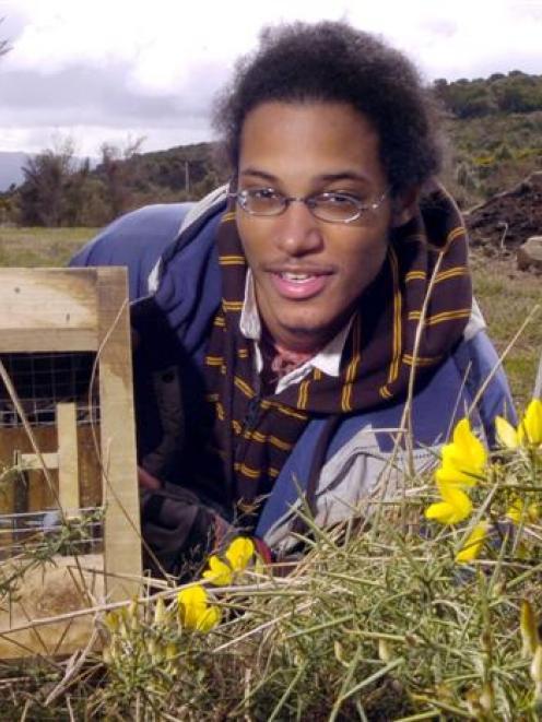 French student Loan Venkatapen sets a possum trap at the Orokonui Ecosanctuary. Photo by Jane...