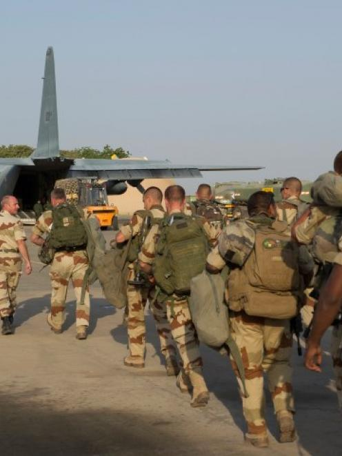 French troops prepare to board a transport plane in N'Djamena, Chad, in this photo released by...