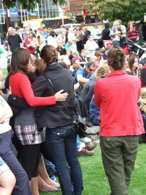 Friends comfort each other after the Kia Kaha Christchurch event, which raised money for the...