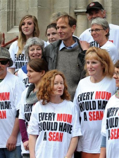 Friends support  Sean Davison (centre)  outside the Dunedin District Court yesterday. Inset, top,...