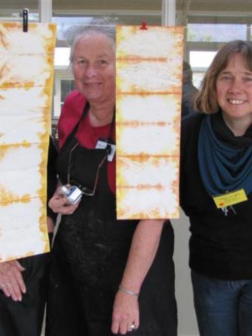 From left, book art class participants Jill Thwaites of Gore, Judy Newbury of Christchurch, Mary...