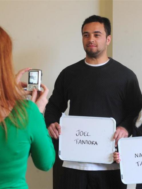 From left, extras casting assistant Jacqui Nairn photographs prospective cast extras Joel and...