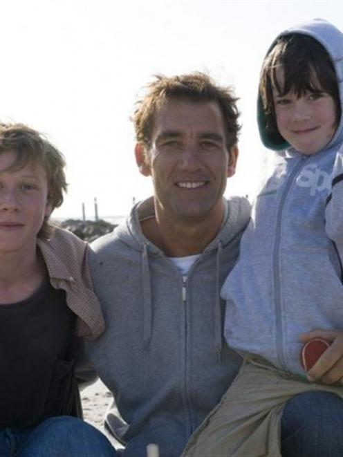 From left: George MacKay, Clive Owen and Nicholas McAnulty in 'The Boys Are Back'.