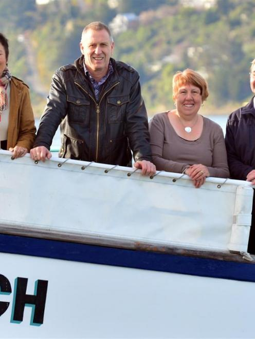 From left, new owners Anita Chan and Neil Harraway, company manager Lynne Hanley and senior...