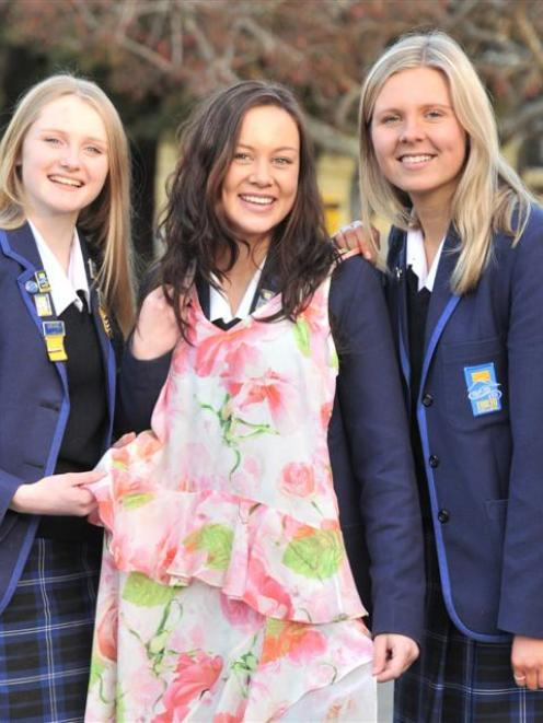 From left, Rebecca Murray (17), Kimberley Bates (17) and Kate Turner (16) before the big night....