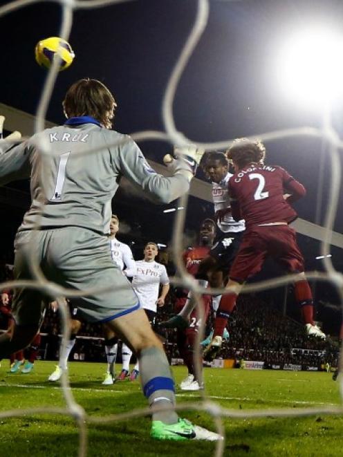 Fulham's Hugo Rodallega (C) scores against Newcastle United during their English Premier League...
