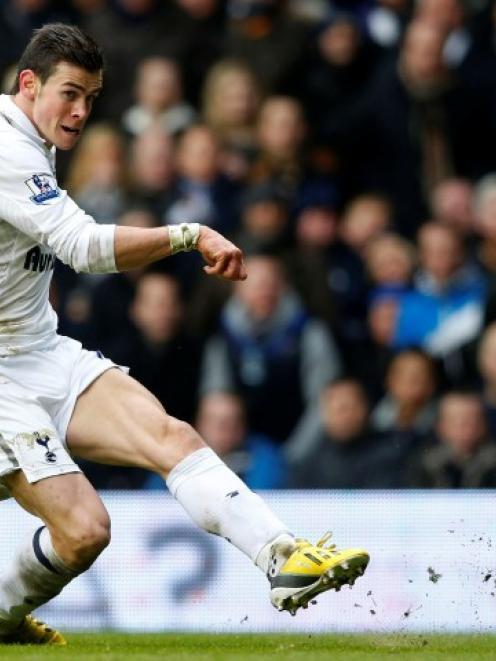 Gareth Bale of Tottenham Hotspur scores his team's second goal against Newcastle United during...