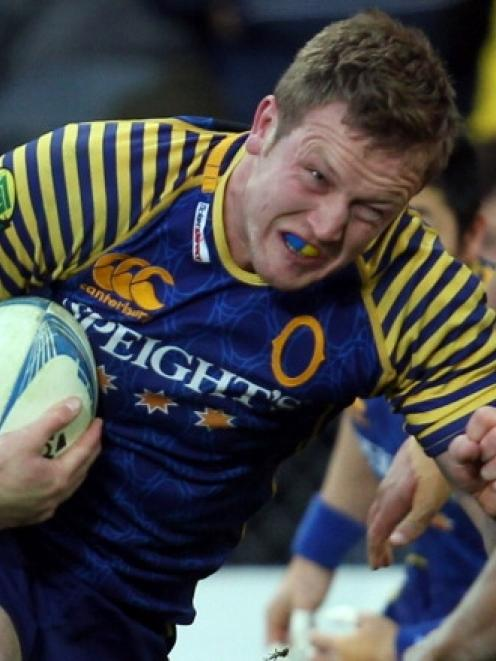 Gareth Evans on the charge for Otago.
