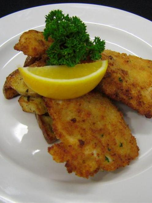 Garlic and rosemary potatoes, served here with crumbed  chicken. Photo supplied.