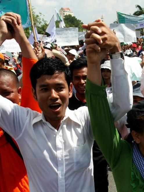 Garment workers shout during a march on the streets to mark International Labor Day in Phnom Penh...