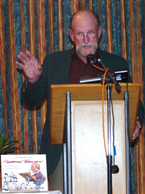Garrick Tremain talks about his work in Dunedin last night. Photo by Peter McIntosh.