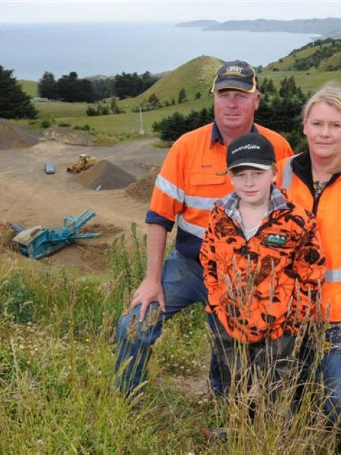Geoff and Tracey Scurr, with son Jack (11), hope to rebuild their Kilmog Quarry business after a ...