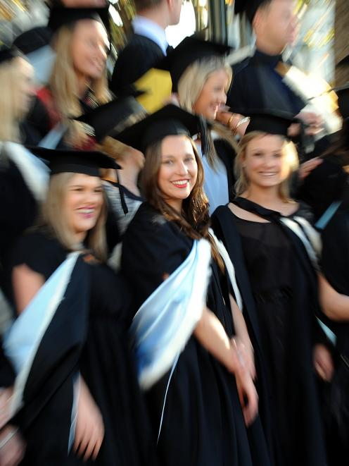 Georgie Austin-Ellas (23, centre) was one of the hundreds of University of Otago graduands to...