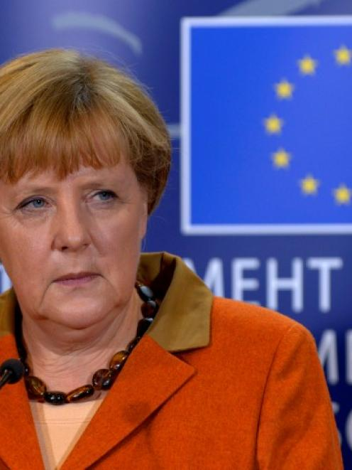 German Chancellor Angela Merkel holds a news conference after addressing the political groups at...