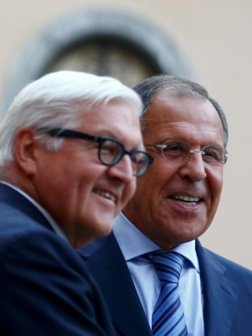 German Foreign Minister Frank-Walter Steinmeier (L) greets his Russian counterpart Sergei Lavrov...