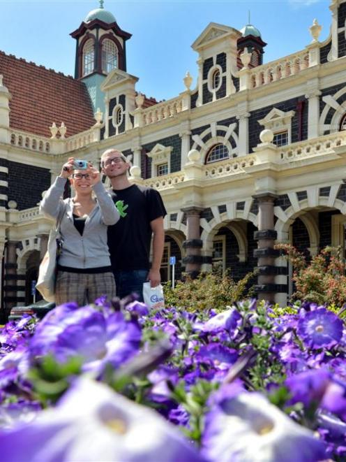 German tourists Julia Ballreich and Alexander Franze take photographs at the Dunedin Railway...