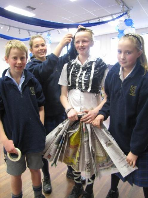 Getting their costume sorted out are Lawrence Area School pupils (from left) Lochie Bain (12),...