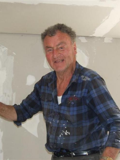 Gib-stopper Kevin Maloney, of Dunedin, works on the Owen home in Kaitangata on Friday. Photos by...