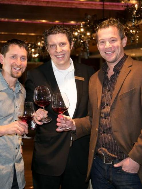 Gibbston Valley winemakers Matt Swirtyz (left) and Chris Keys  (right)  sample wines with Hilton...